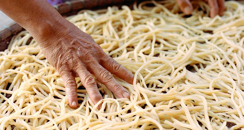 Making Cao Lau noodles